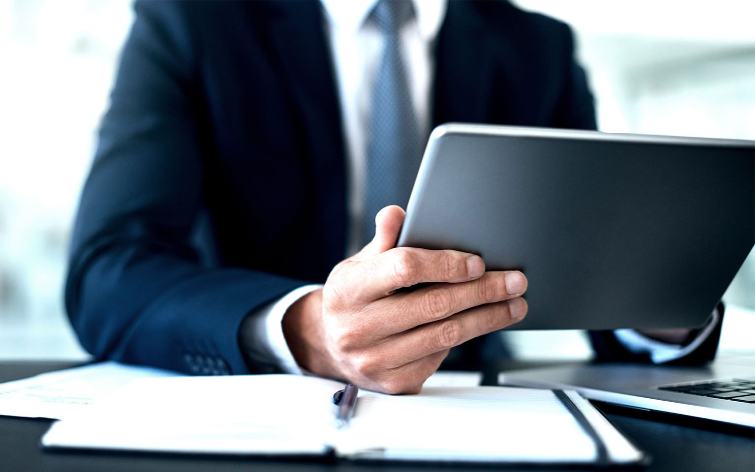 close up of businessman holding tablet